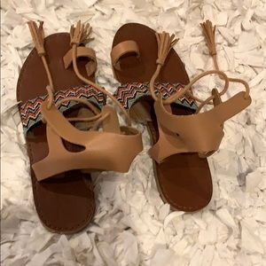 Brown sandals with colorful chevron and fringe tie